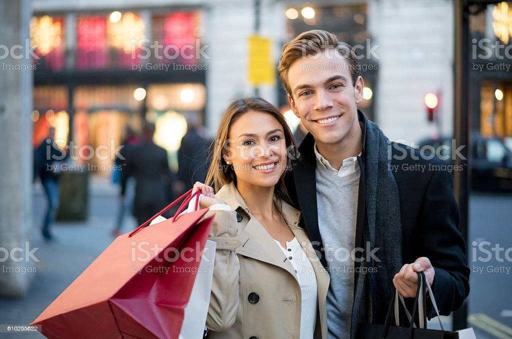 Portrait of a happy couple shopping stock photo