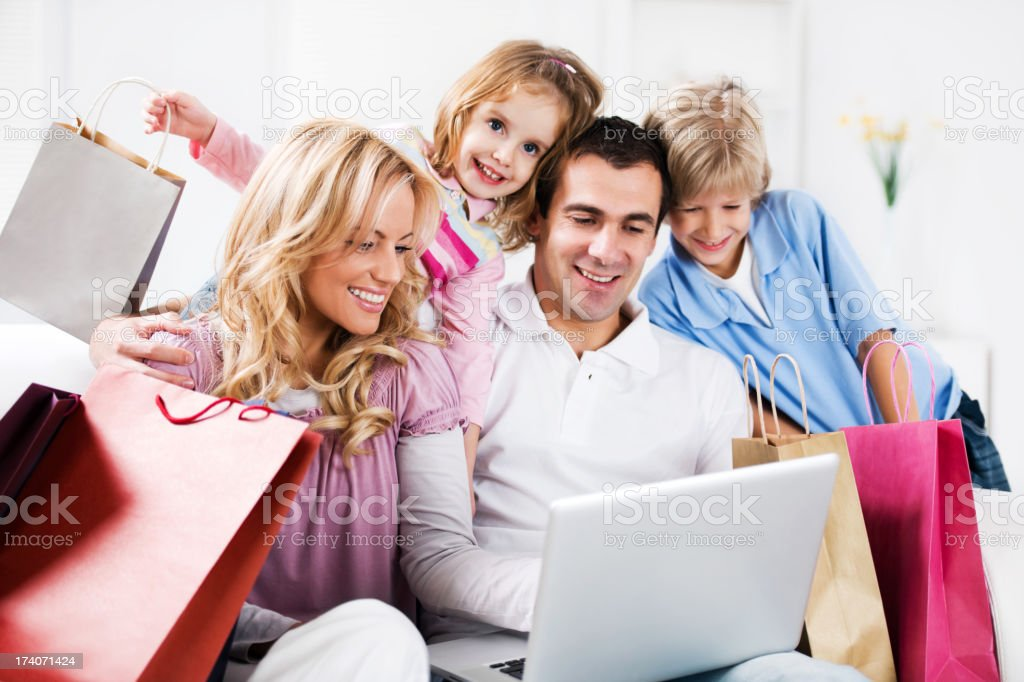 Portrait of a happy family having online shopping. royalty-free stock photo