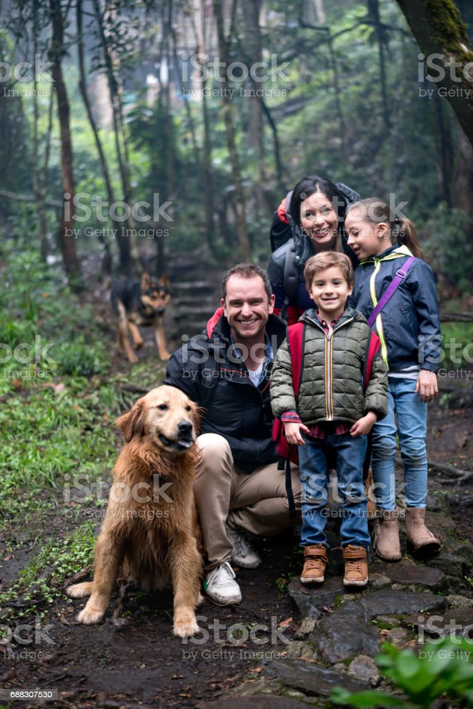 Portrait of a happy family hiking outdoors stock photo