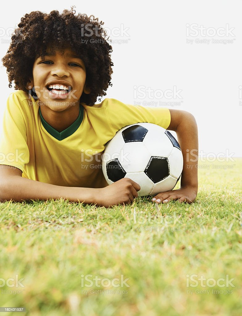 Portrait of a happy football player lying on the field royalty-free stock photo