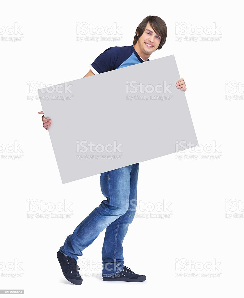 Portrait of a happy guy holding placard royalty-free stock photo