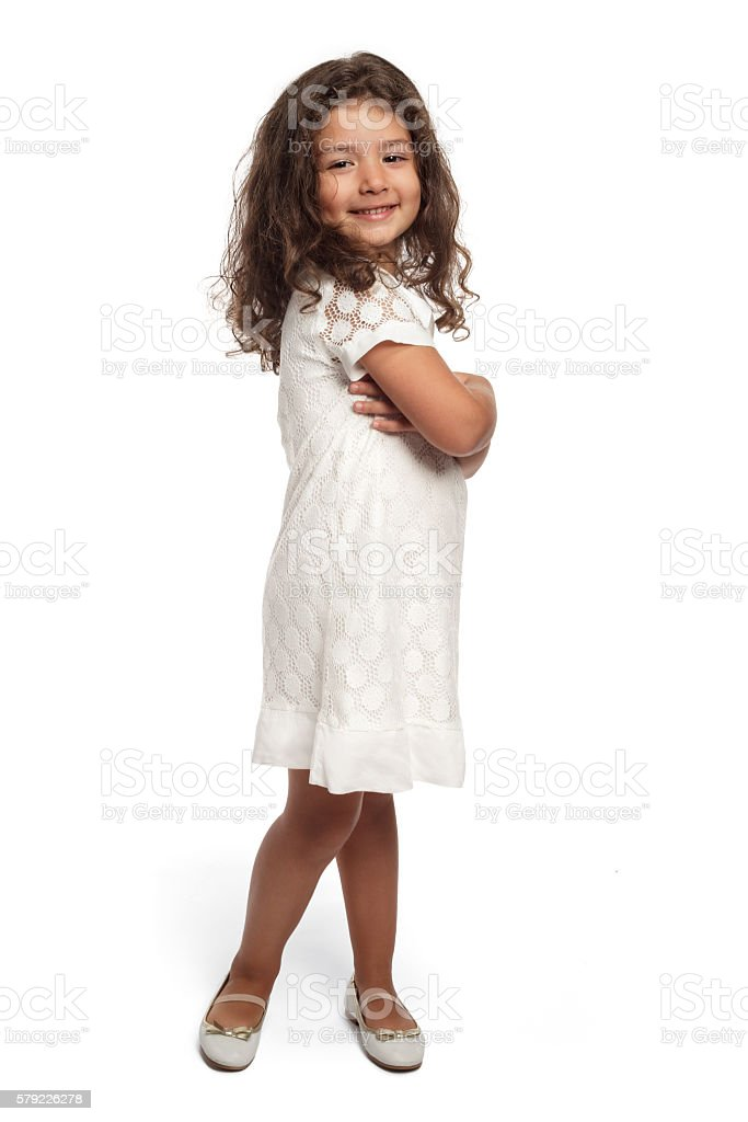 Portrait of a happy little girl on white background stock photo