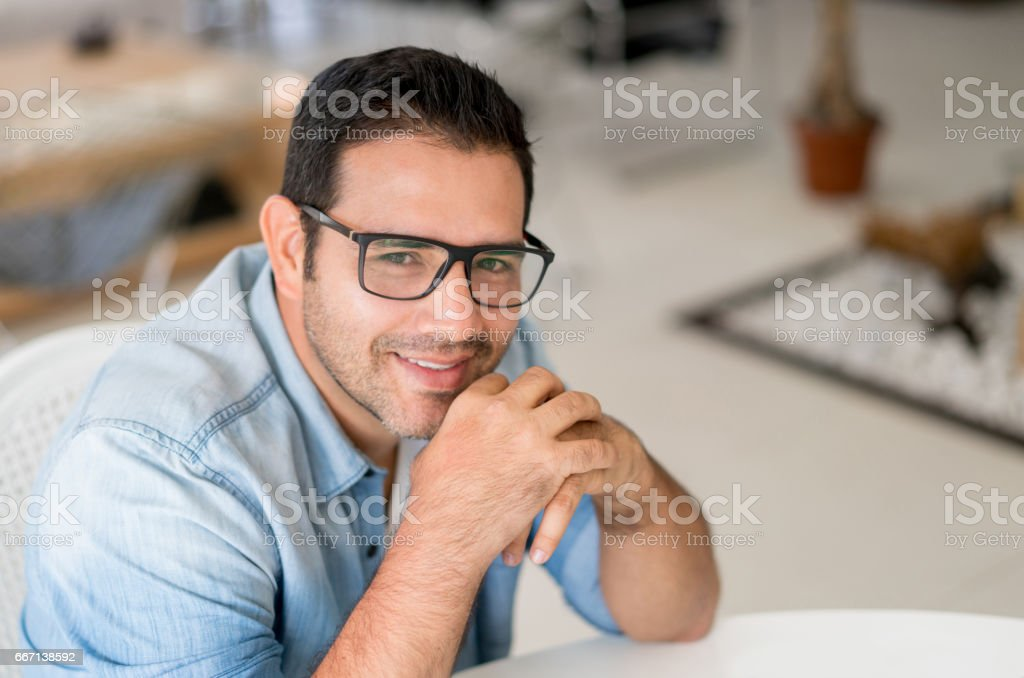 Portrait of a happy man at home stock photo