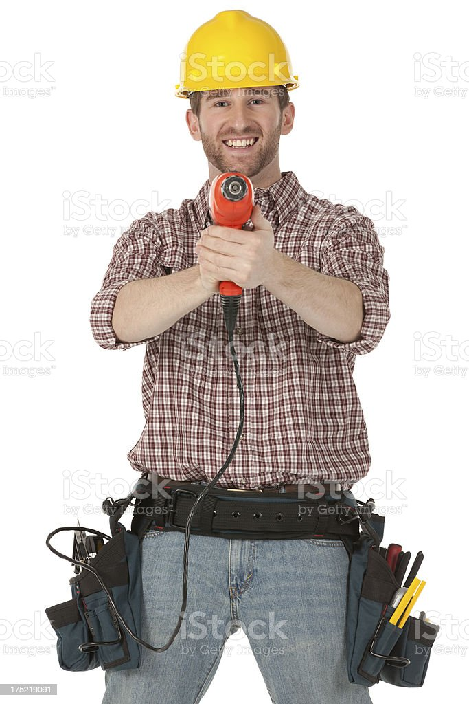 Portrait of a happy manual worker drilling royalty-free stock photo