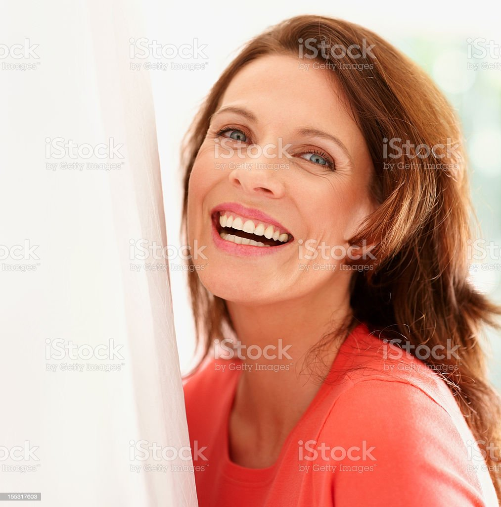 Portrait of a happy mature lady stock photo