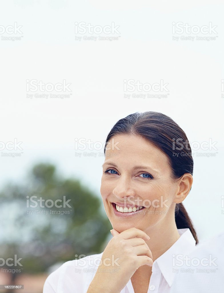 Portrait of a happy mid adult lady royalty-free stock photo