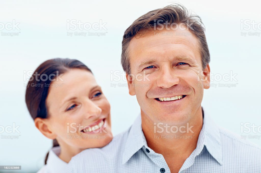 Portrait of a happy middle aged couple isolated on white stock photo