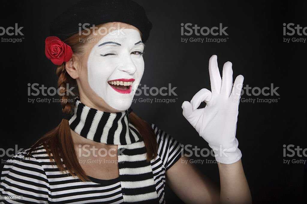 Portrait of a happy mime comedian showing OK royalty-free stock photo