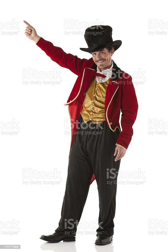 Portrait of a happy ringmaster pointing stock photo