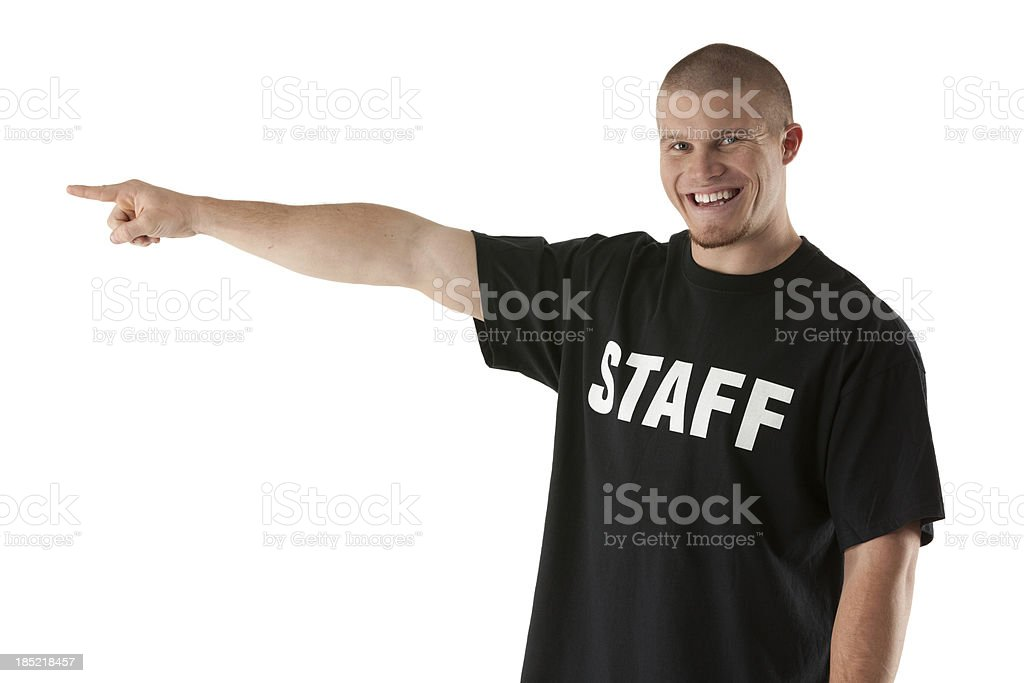 Portrait of a happy security guard pointing royalty-free stock photo
