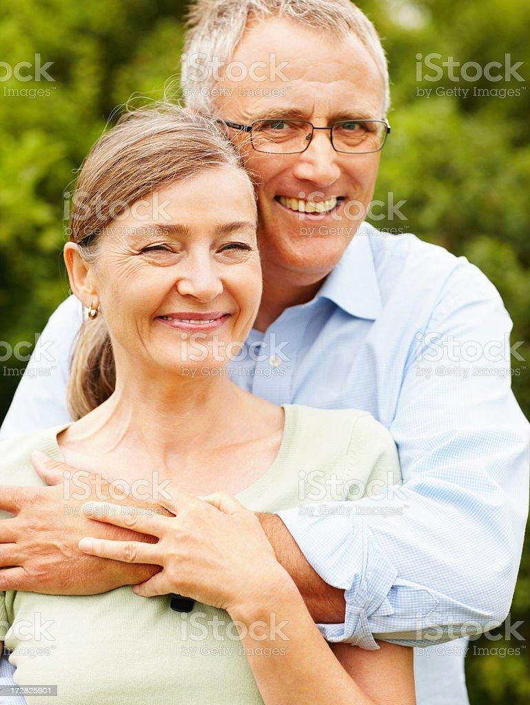 Portrait of a happy senior couple at a park stock photo