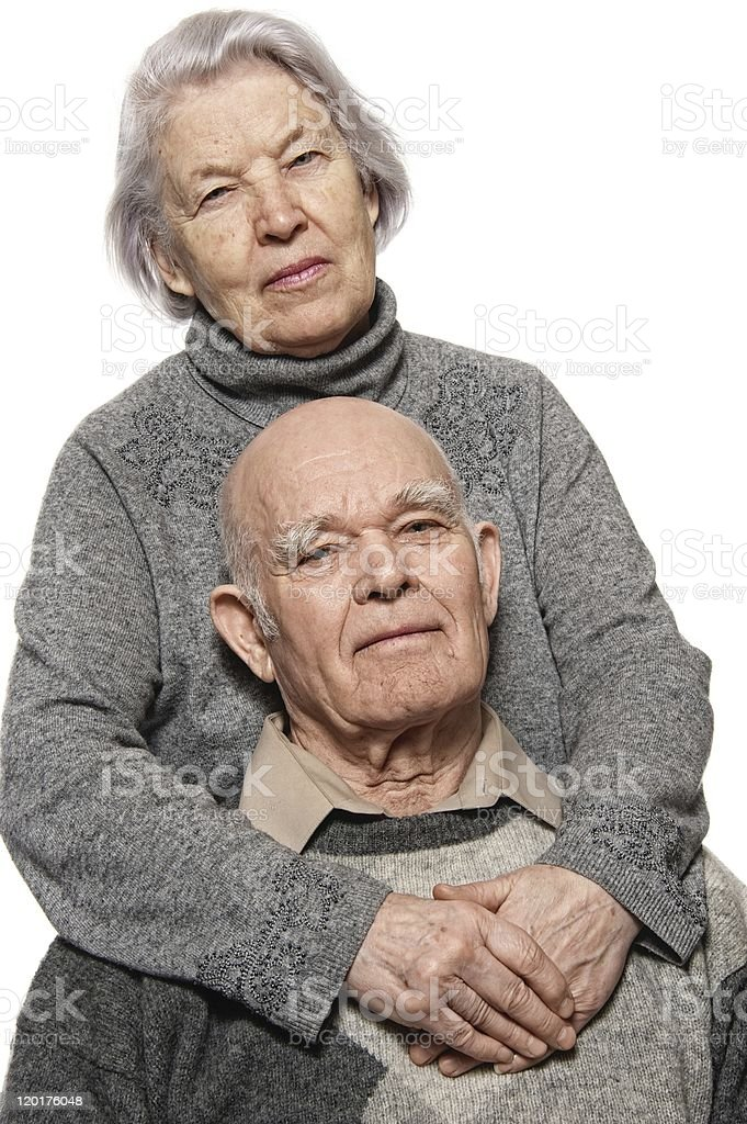 Portrait of a happy senior couple embracing each other royalty-free stock photo