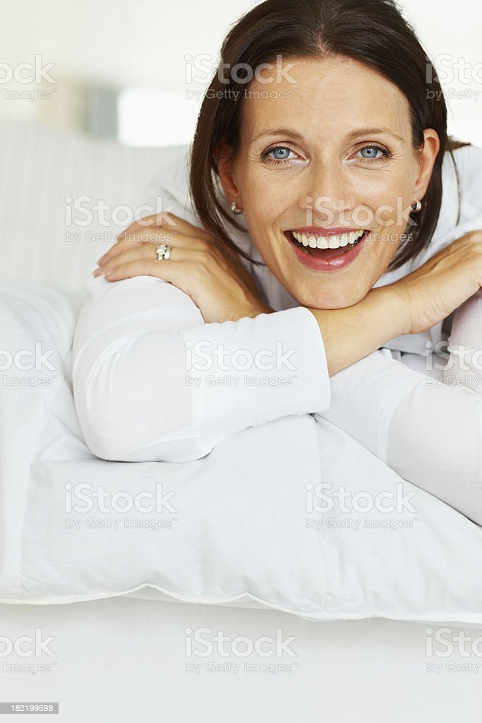 Portrait of a happy woman lying on bed royalty-free stock photo