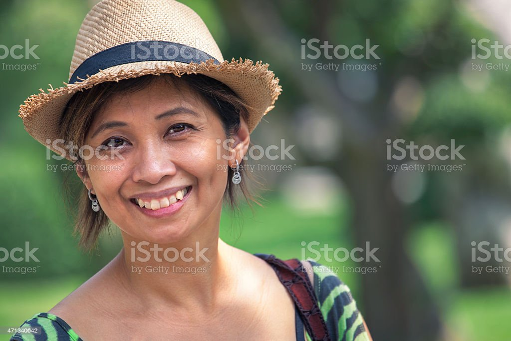 Portrait of a happy woman outdoors in the park stock photo