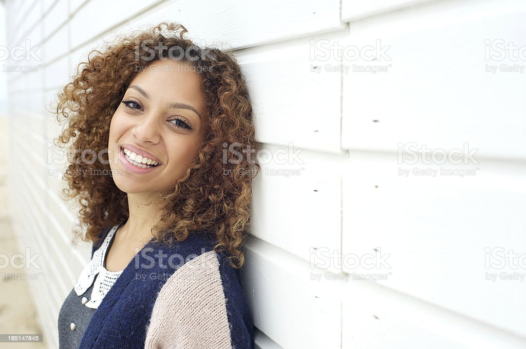Portrait of a happy young attractive female smiling outdoors stock photo
