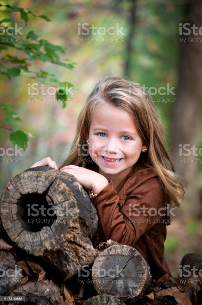 Portrait of a Happy Young Girl in the Forest stock photo
