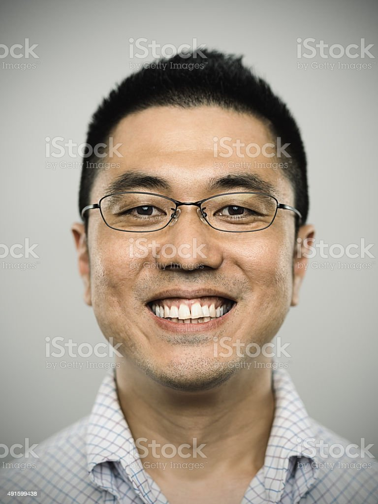 Portrait of a happy young japanese man looking at camera stock photo