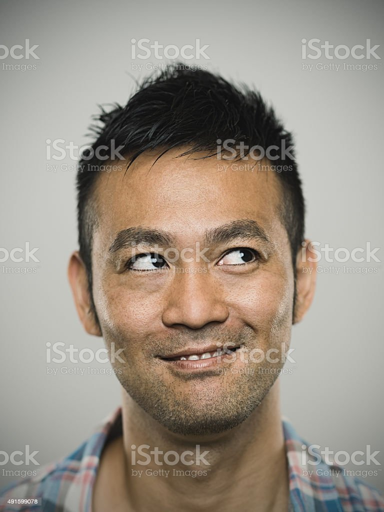 Portrait of a happy young japanese man stock photo