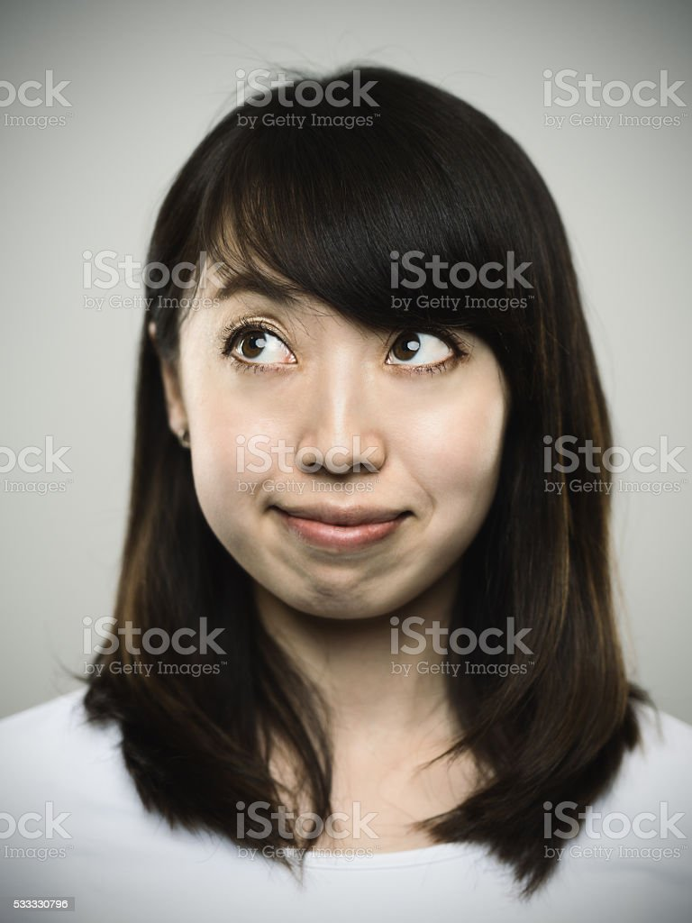 Portrait of a happy young japanese woman looking to stock photo