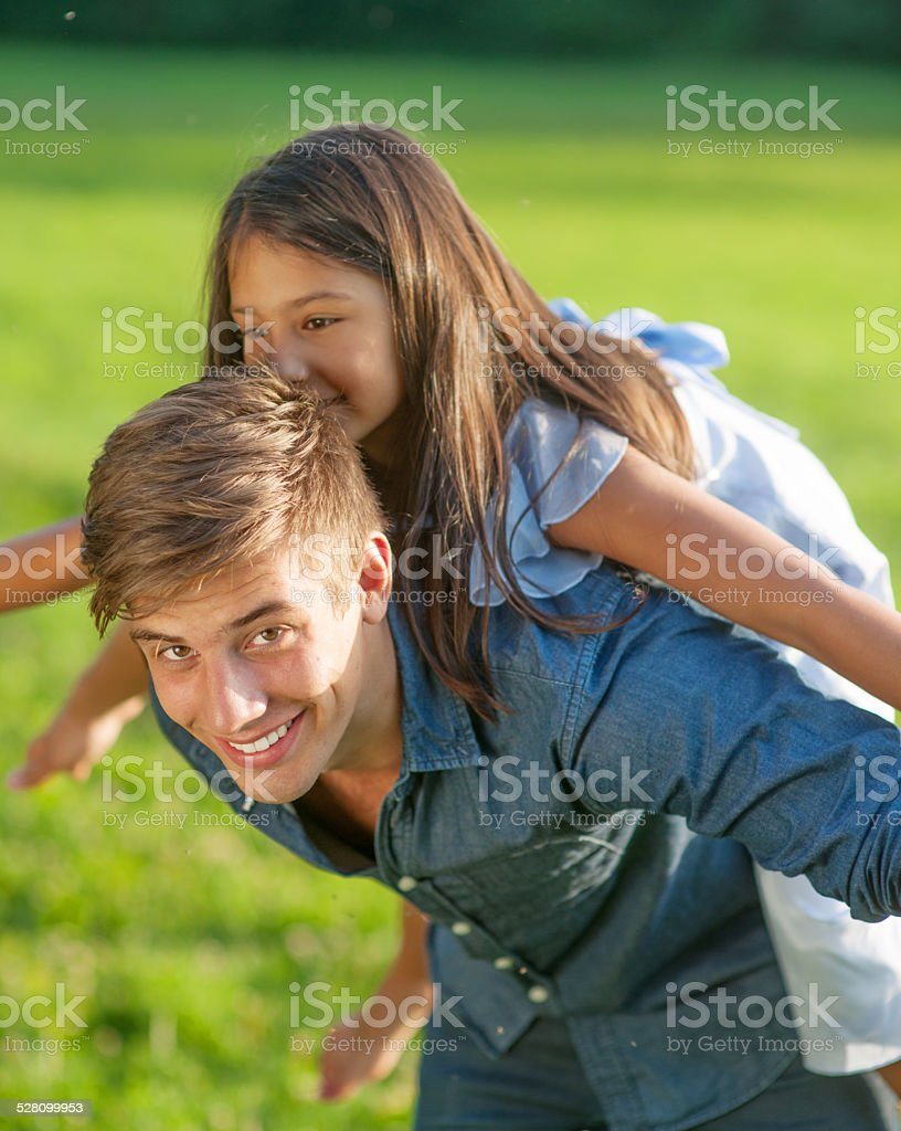 Portrait of a happy young man in nature, chewing stock photo