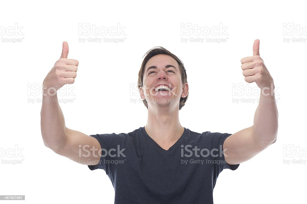 Portrait of a happy young man with thumbs up gesture royalty-free stock photo