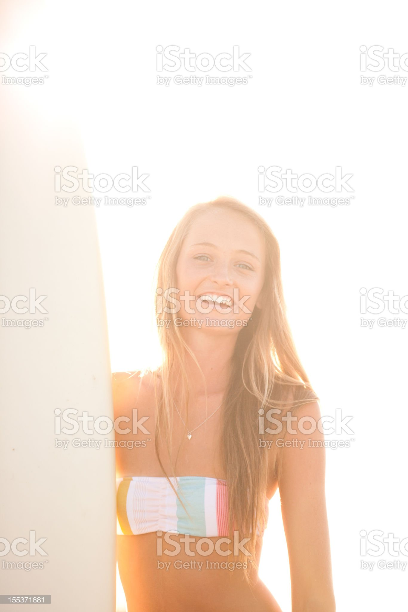 Portrait of a happy young surfer girl at the beach royalty-free stock photo