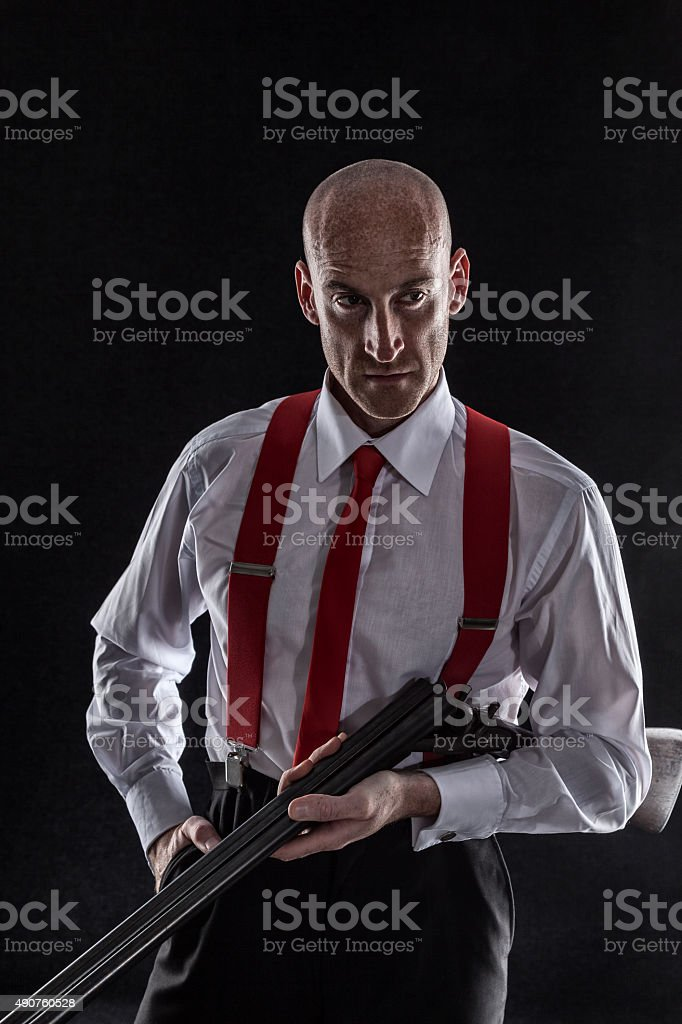 Portrait Of A Hard Man With His Shotgun stock photo