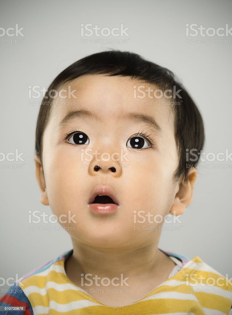 Portrait of a japanese baby looking at camera stock photo