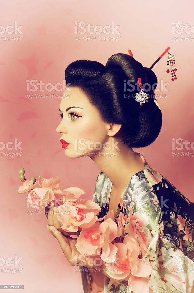 Portrait of a Japanese geisha woman with flower stock photo