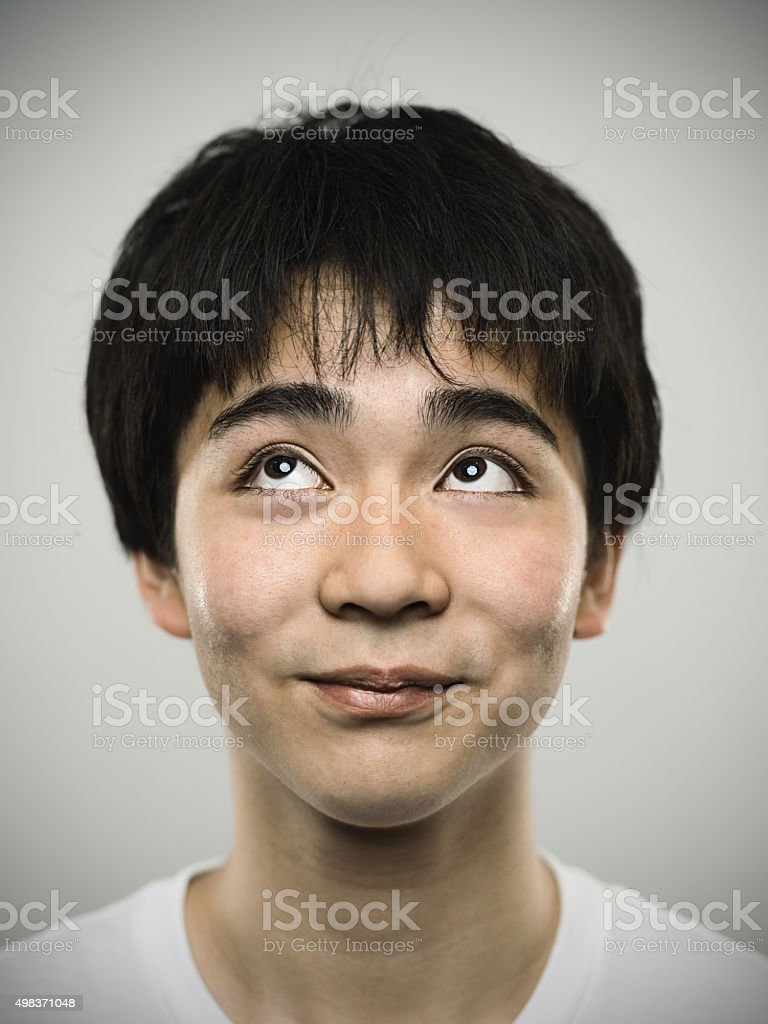 Portrait of a japanese happy teenager looking at camera stock photo
