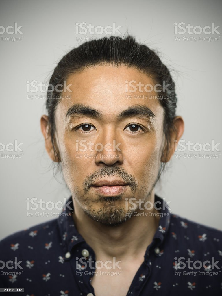 Portrait of a japanese man looking at camera. stock photo