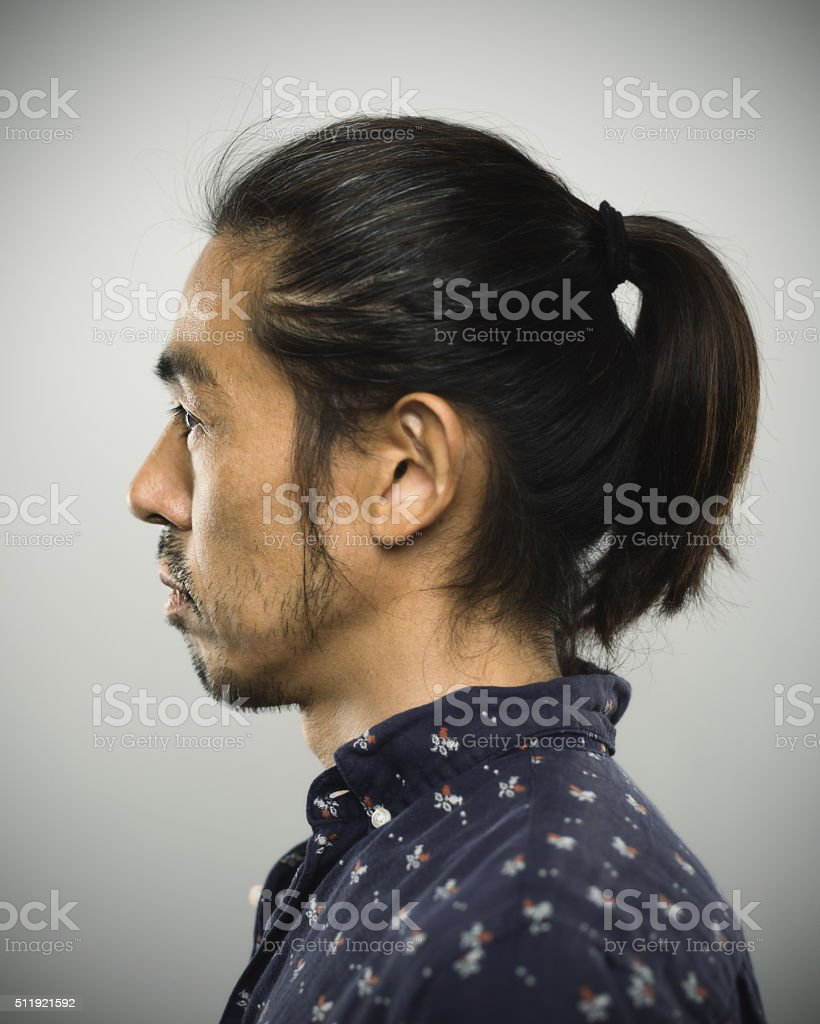 Portrait of a japanese man looking at camera stock photo