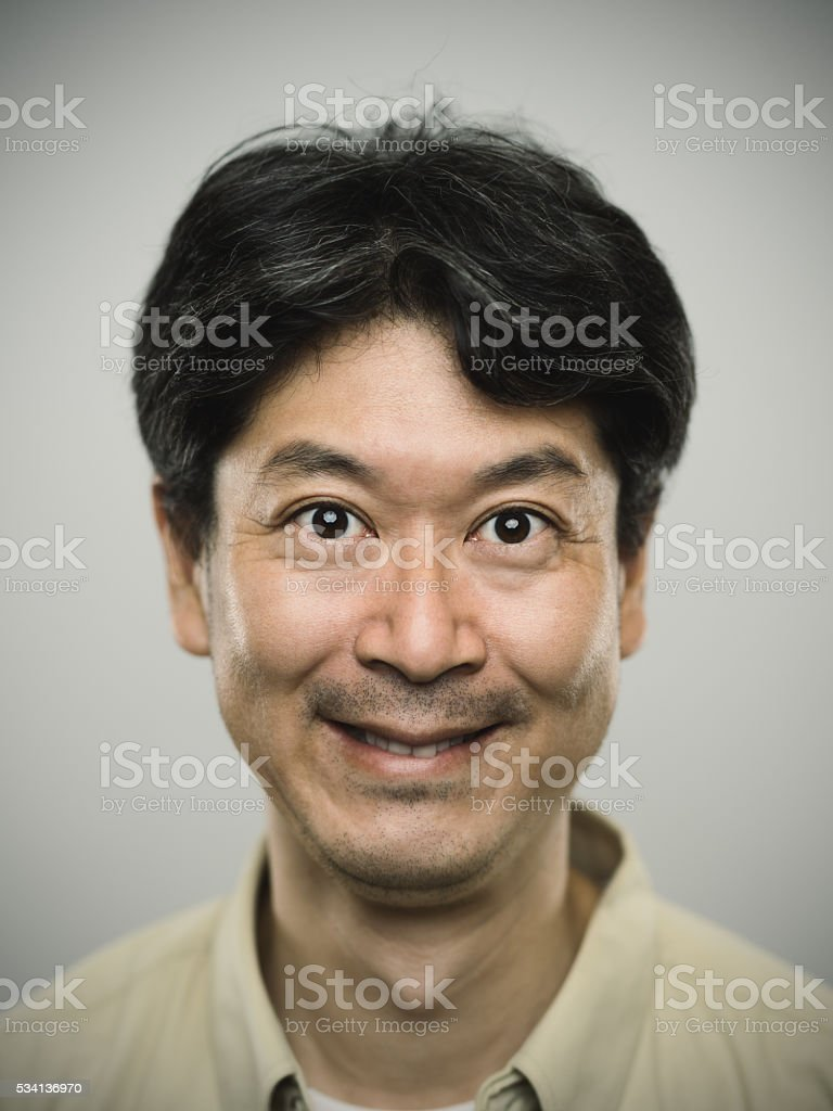 Portrait of a japanese man with happy expression. stock photo