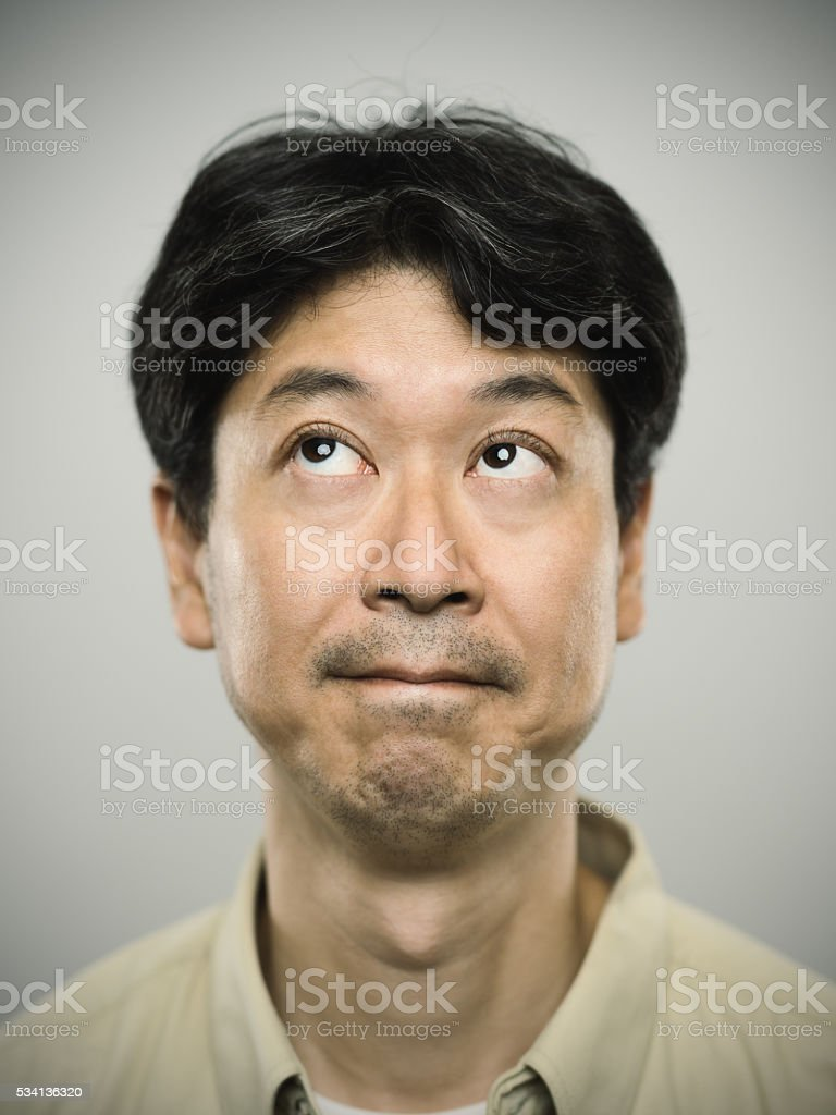 Portrait of a japanese man with pensive expression. stock photo