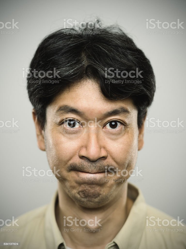 Portrait of a japanese man with severe expression. stock photo