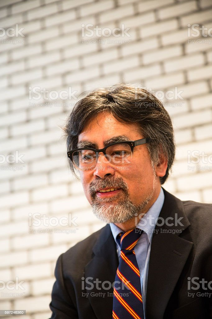 Portrait of a Japanese senior male wearing glasses stock photo