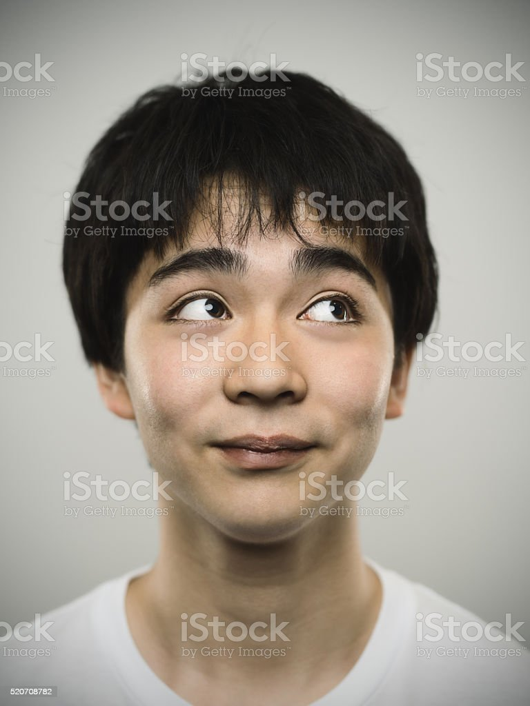 Portrait of a japanese teenager looking up. stock photo