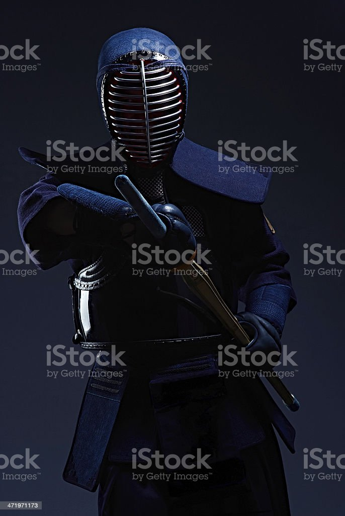 portrait of a kendo fighter with shinai stock photo
