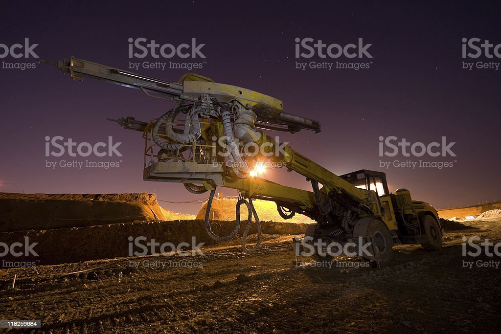Portrait of a large heavy drilling machine under a dusk sky royalty-free stock photo