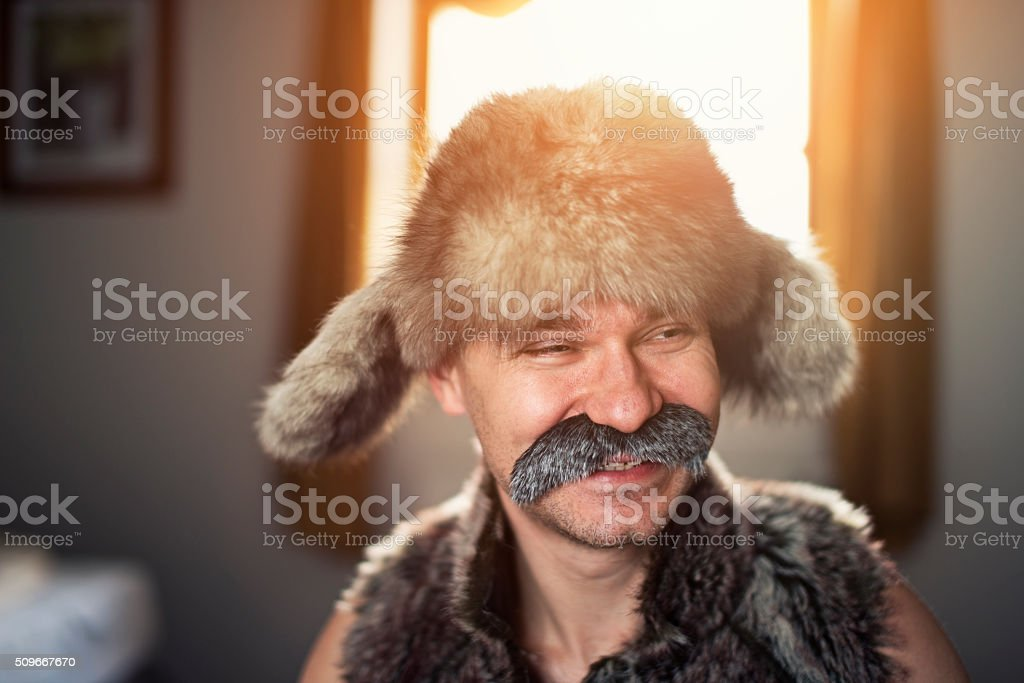 Portrait of a laughing man with big moustache stock photo