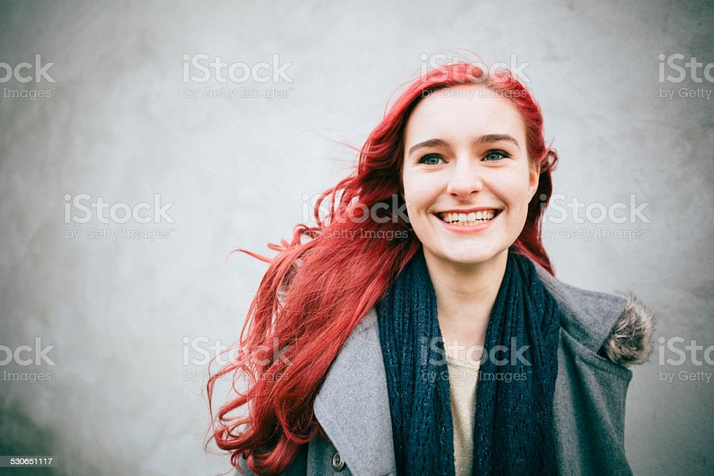 portrait of a laughing redhead teenager girl stock photo