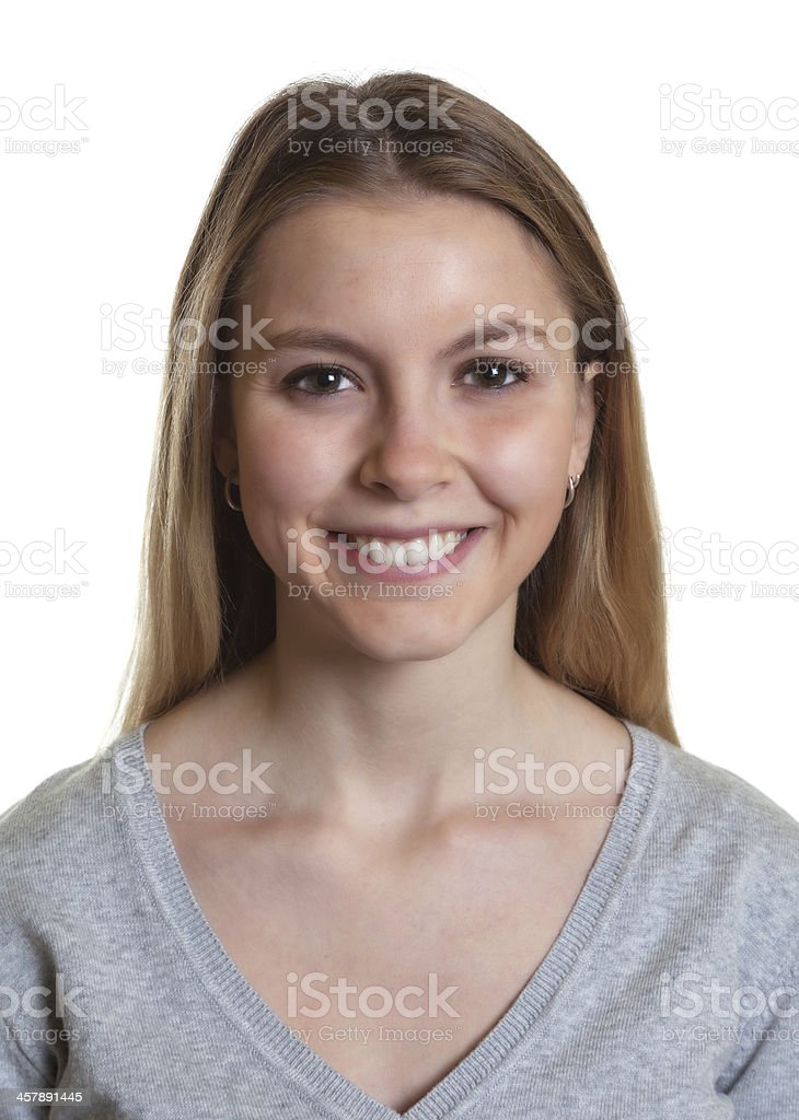 Portrait of a laughing woman in grey sweater stock photo