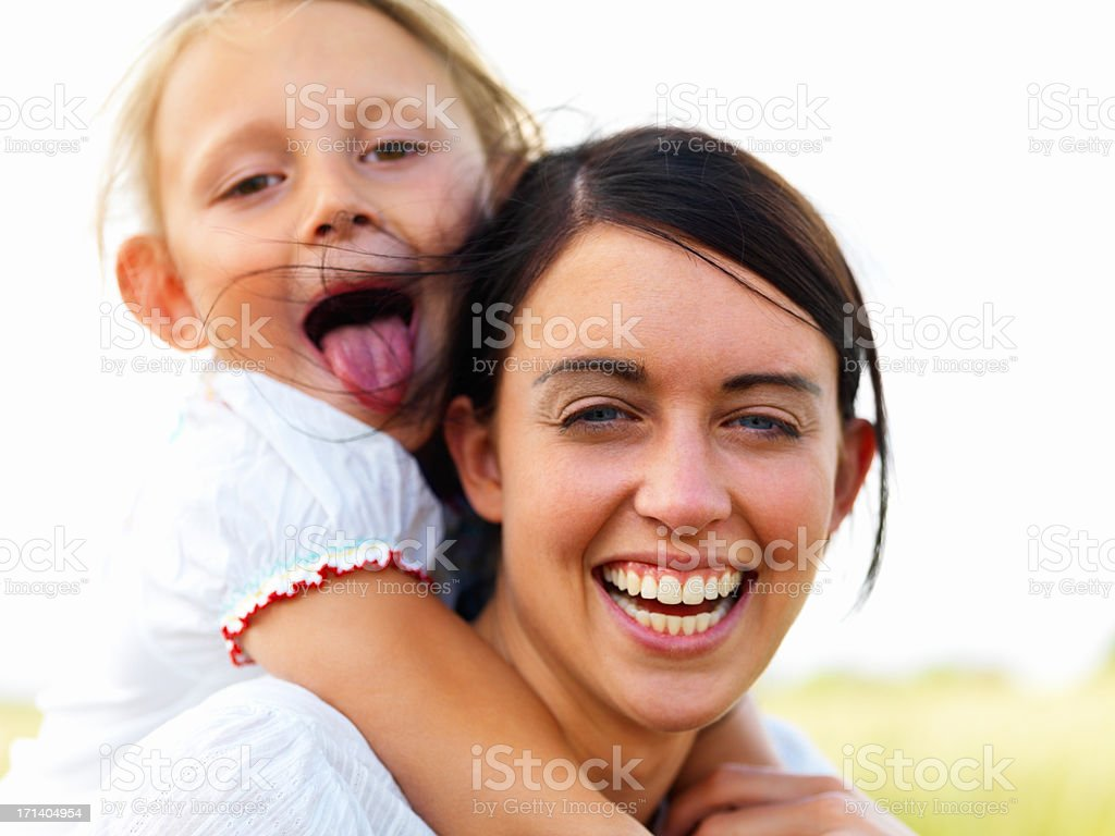 Portrait of a laughing young mother with her daughter royalty-free stock photo
