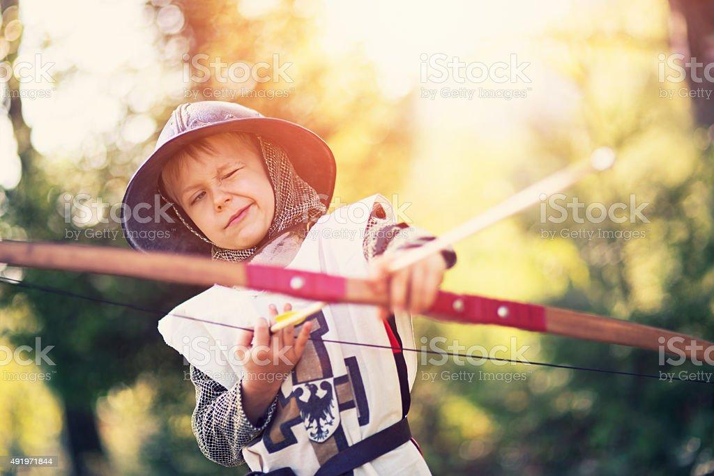 Portrait of a little archer boy stock photo
