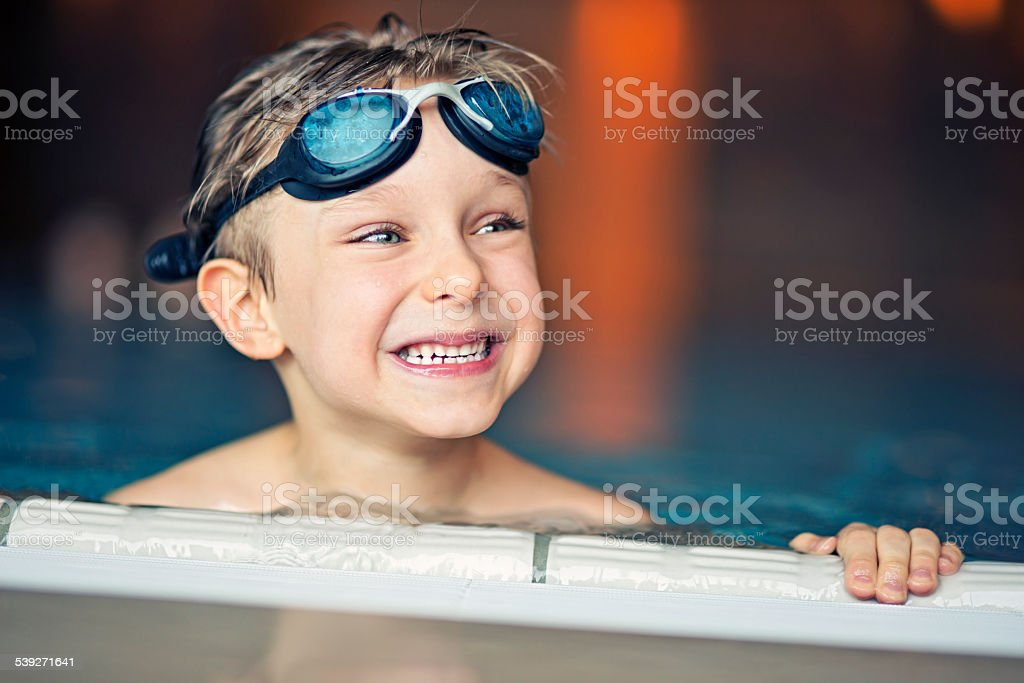 Portrait of a little boy in swimming pool stock photo