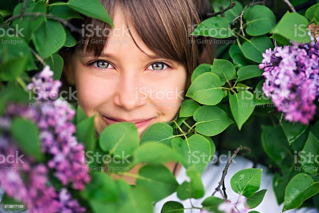 Portrait of a little girl in lilac stock photo