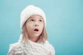 portrait of a little  girl in white hat and scarf