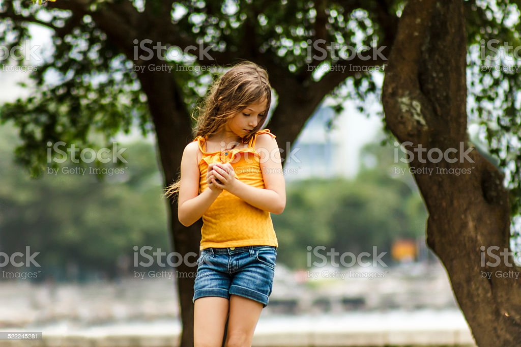 Portrait of a Little Girl Playing in Park stock photo