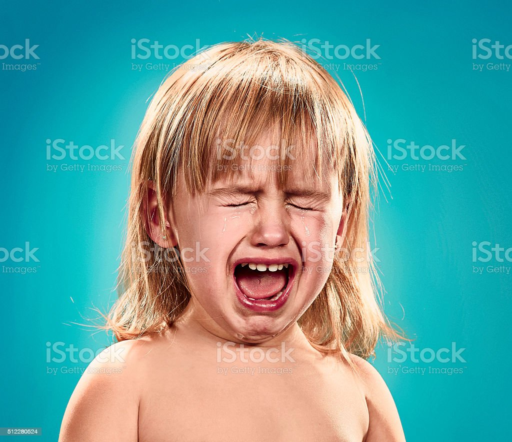 Portrait of a little girl. She is crying stock photo