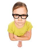 Portrait of a little girl wearing glasses